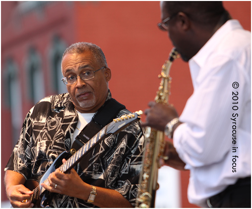 Urban Jazz Collective's Duane Tribune (left) and Richard Randolph play on stage in Little Italy