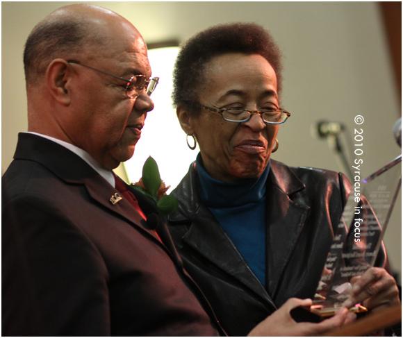 Charles Anderson presenting an award to Dr. Sylvia Norton