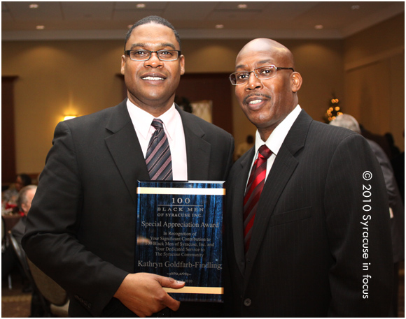 Mark Muhammad (left) accepting award for The Gifford Foundation's Kathy Goldfarb Findling with Chapter President Vincent Love