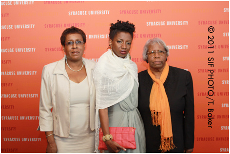 Designer Syreeta Chantal Herbert (center) with her family in New York. Herbert's designs were featured in the 2011 Gala on Thursday.