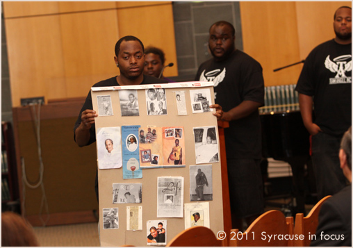Ed Mitchell, Jr. shows a memorial poster made by teens in the Team A.N.G.E.L. Program
