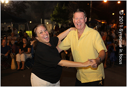 La Liga's Rita Paniagua and CNYJAF's Larry Luttinger Dance on Oswego Street