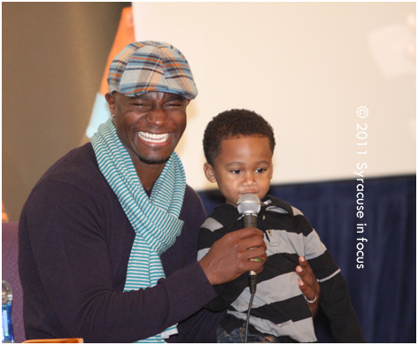 Taye Diggs gets some help during a song peformance with Shane Evans at the Greater Evangelical COGIC