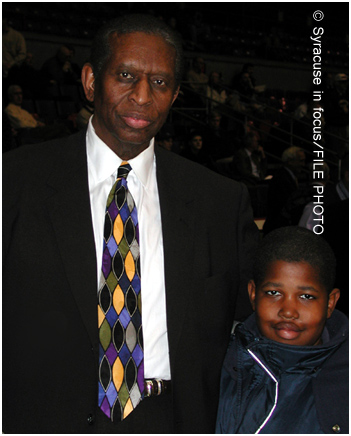 NBA Hall of Famer Earl Lloyd visits with Aaron Allen at the War Memorial in 2000.