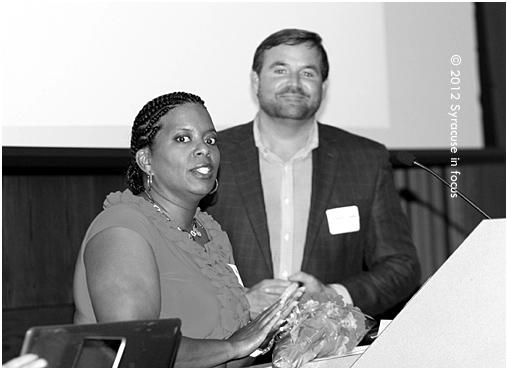 Vision Center Program Director Gina Rivers along with Rev. John Carter salute graduates of the 2012 Synergy Program during a ceremony at Upstate Medical Center on Friday.