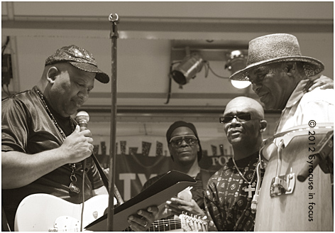 The Blacklites' Emanual Atkins reads a proclaimation from the band to Professor Rick Wright, the on-air personality from 620AM.