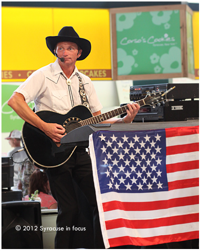 Matthew Chase, sings in the Dairy Building at the NYS Fair