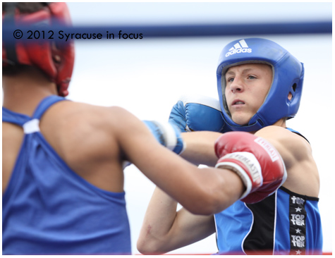 Jordan Adamson of St. Catherines Ontario (Canada) prepares to throw an overhand right during his bout.