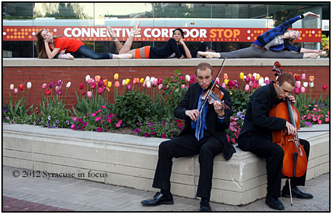 Nothing but strings: The McGriff brothers may be Syracuse's best kept classic secret. The are pictured here as part of the Connective Corridor's In Motion Series from the Spring.