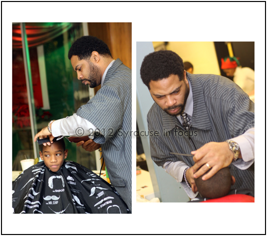 Ed Perry, owner E-Clipz Barbershop, works at the Cut-A-Thon on Wednesday.