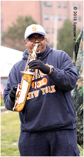C. Robinson, aka the Saxman, serenaded fans on their way to the Dome today.