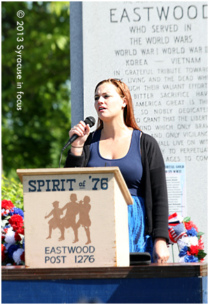 Amanda Marzullo sings after the Eastwood Memorial Day Parade