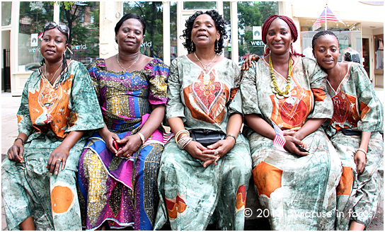 Ladies from the Central African Republic rest after their dance performance on stage in Hanover Square. The ladies came to Syracuse about one year ago