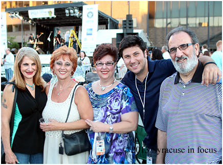 Smooth Sax artist Al Cutri (second from right) comes from a family of talented musicians. He took time to chill with his family after playing a white hot set with his band Blowin' in the Wind on the opening day of the Northeast Jazz & Wine Festival (Clinton Square).