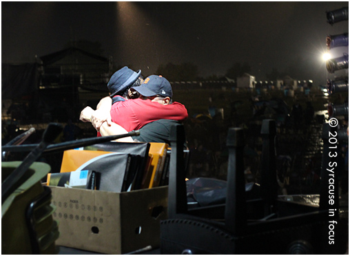 Napoleon Murphy Brock of the Grandmothers of Invention and Festival Producer Frank Malfitano hug it out during a lengthy rain delay.
