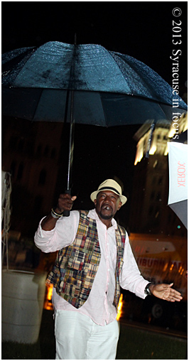 Blame it on the Rain: A die-hard fan dances to a rendition of Mr. Magic by the All-Star Jam Session Band.