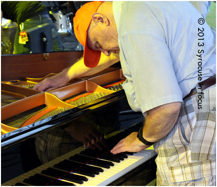 Piano Tuner Kenny Williams has been working festivals and concerts in Syracuse for more than a half century.