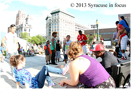 Some folk from the Syracuse Dance Project, along with some freelancers, occupy the Soldiers and Sailors Monument in Clinton Sqaure between the World Beat and Mardi Gras Pavillions.