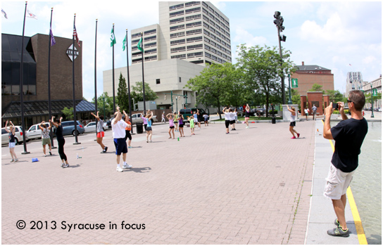 Randy Sabourin takes a video of the Wednesday class in Clinton Square.