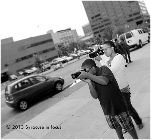 Journalist/Photographer LaVergne Harden and her son working in downtown Syracuse.