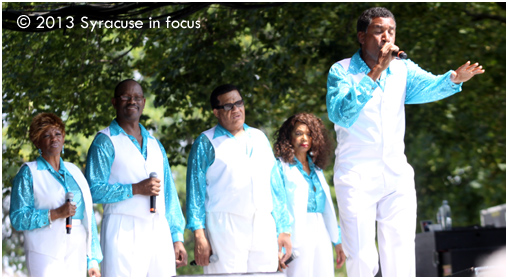 "The 5th Dimension brought back good memories during yesterday's New York State Fair performance. The group consists of (from left to right) Patrice Morris, Floyd Smith, Willie Williams, (original member) Florence LaRue and Leonard Tucker. Tucker sings here from their hit ""Wedding Bell Blues."""