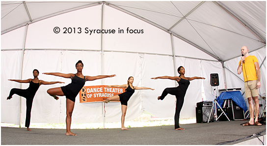 Members of the Dance Theater of Syracuse, under the direction of Brandon Ellis, showed some of their warm-up routine at the Pan-African Village on Friday.