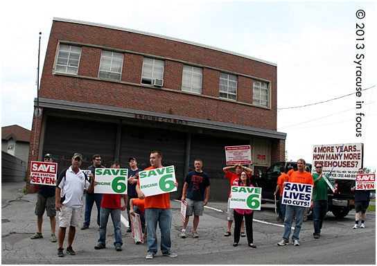 Firehouse advocates and supporters of Pat Hogan rally to get out the vote on East Fayette Street on Monday.