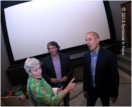 Paul Kentoffio and Basil Anastassiou meet with supporters after a screening of their film in Manlius on Friday.
