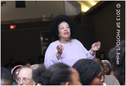 Poet Jackie Warren-Moore asks her question for the panel.