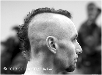 The Mohawk hairstyle has numerous varieties, but its origins date back thousands of years. We saw this freshly quaffed version during a martial arts tournament.