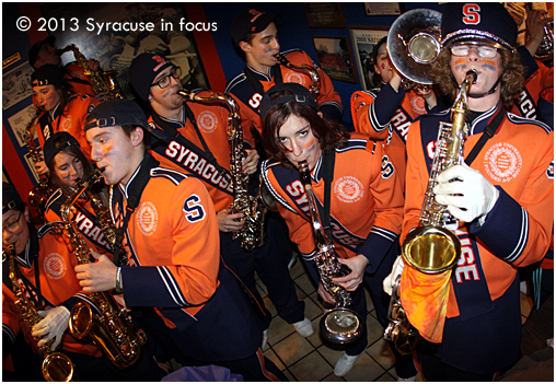 The Syracuse University Football Team became bowl eligible after Saturday's final minute, 34-31 win over Boston College. The party continued when the marching band played inside Varsity Pizza.