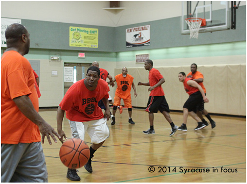Don Crouch (center) and Flav's Unit turned up their man-to-man defense pressure to close the gap in the second half.