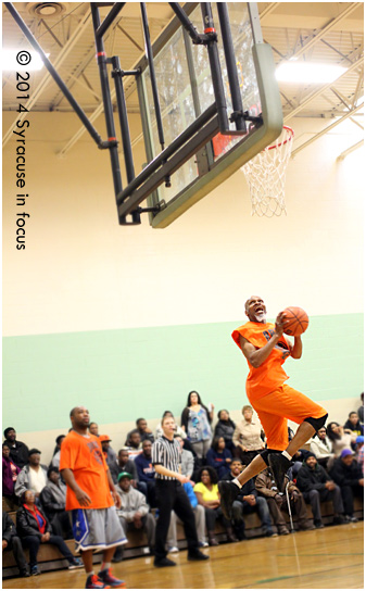 """Julius """"Pop"""" Anderson floats to the basket for a layup in the final minute of the second half."""
