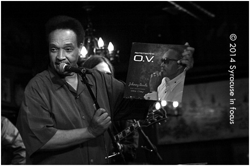 "Happy National Record Store Day: Blues singer Johnny Rawls holds up his latest ""album"" during a performance at the Dinosaur Bar-B-Que."