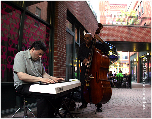 Syracuse Jazz Masters Dave Solazzo and Bill Horrace played a concert in the courtyard near Lemon Grass + Bistro Elefant on Friday night.