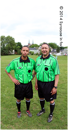 Former SU Soccer player Charles Schoenig and his father Ken share a love for soccer. The two men refereed the soccer tournament for World Refugee Day at Schiller Park yesterday.