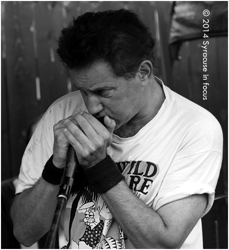 Sunny with a chance of the Blues: Bruce plays harmonica in the Bone Yard with the Double Barrel Blues Band Thursday evening to kick off the NYS Blues Fest