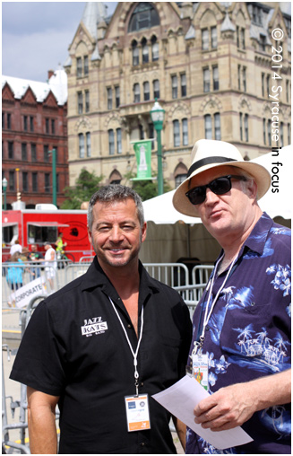 Band leader and sax player Dave Frateschi and Journalist Russ Tarby at the Battle of the Community Bands in Clinton Square.