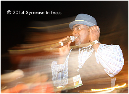Mike Houston sings his way through the crowd to close out Day 1 of the Northeast Jazz and Wine Festival last night.