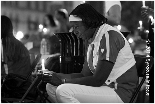 Common Councilor Helen Hudson takes a moment to reflect at the Mothers Against Gun Violence 12th Annual Candlelight Vigil Sunday evening in Clinton Square.