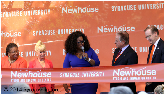 Earlier today media pioneer Oprah Winfrey (center) leads a ribbon-cuttting at the Newhouse School of Public Communications with (from left) Dean Lorraine Branham, Kari Clark (widow of Dick Clark), Alan Gerry and Chancellor Kent Syverud.