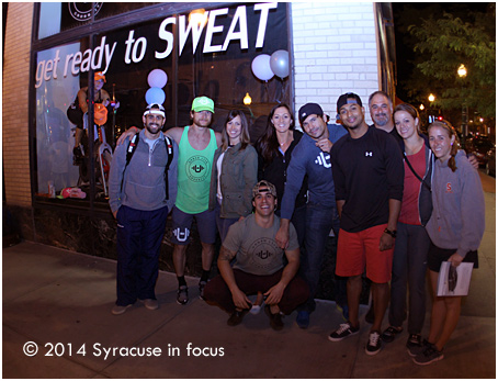 The Urban CrossFit Posse poses in front of their window for the Live Models Landmark project on Tuesday night.