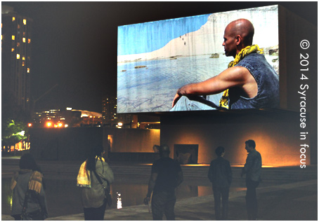 Urban Video Project screened Western Union: Small Boats by Issac Julien in Everson Plaza