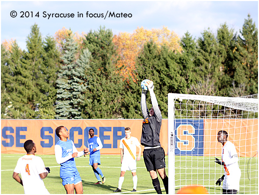 Keeper: Syracuse University's Alex Bono (from Baldwinsville) skies to defend the goal in the second half.