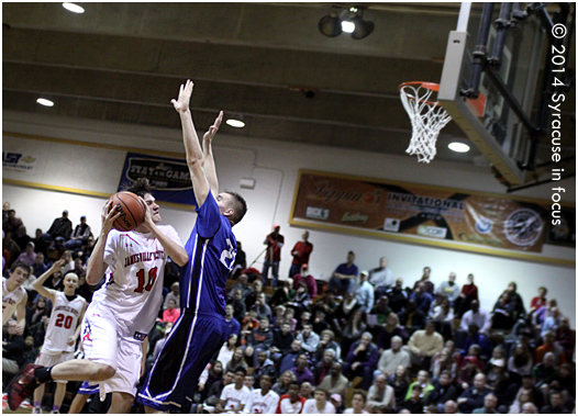 JD's Jim Boeheim meets resistance from Westhill's Tyler Reynolds.