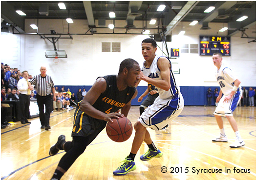 Henninger point guard Romero Collier (4) drives baseline in yesterdays game versus Westill.
