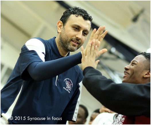 By the fourth quarter the game was out of reach and Coach Gokce went down the bench for high fives from his players.