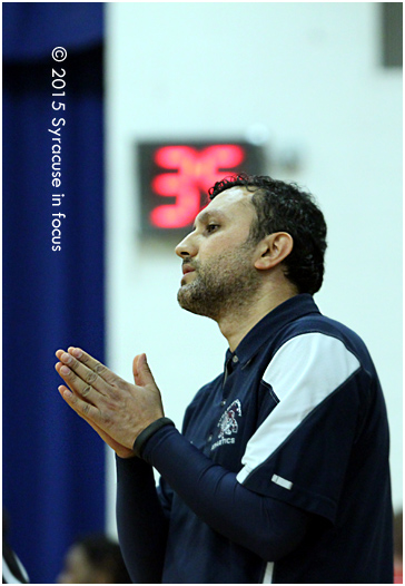 Syracuse Academy of Science (SAS) Coach Onur Gokce tries to calm a player after a technical foul call in last night's win over ITC.