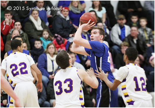 Westhill Forward Tyler Reynolds goes for two of his game-high 23 points.