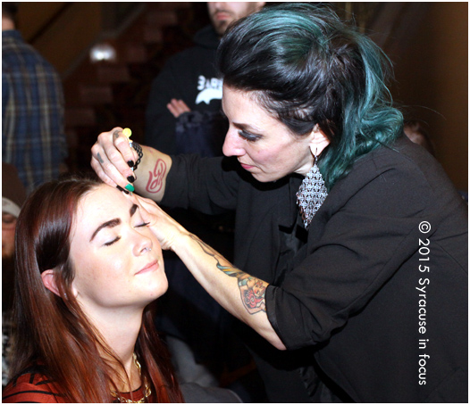 Shannon Fleming (right) preps a contestant at the Festival of the Fantastical Facial Follicle.